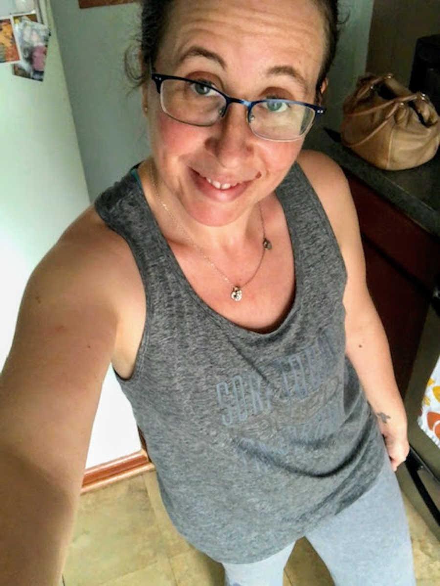 Woman taking smiling selfie