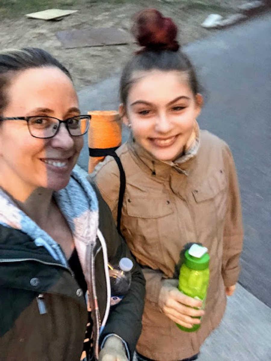 Two women standing outside taking smiling selfie