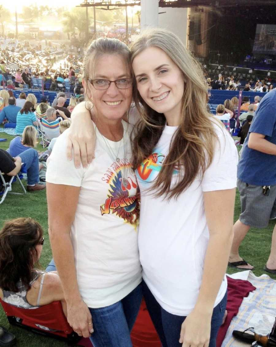 Mother and daughter smiling at a concert