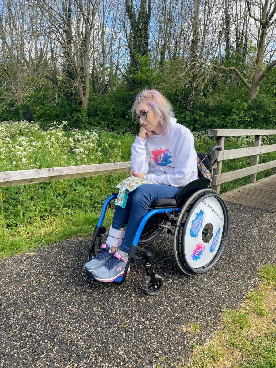 Woman in wheelchair on nature path