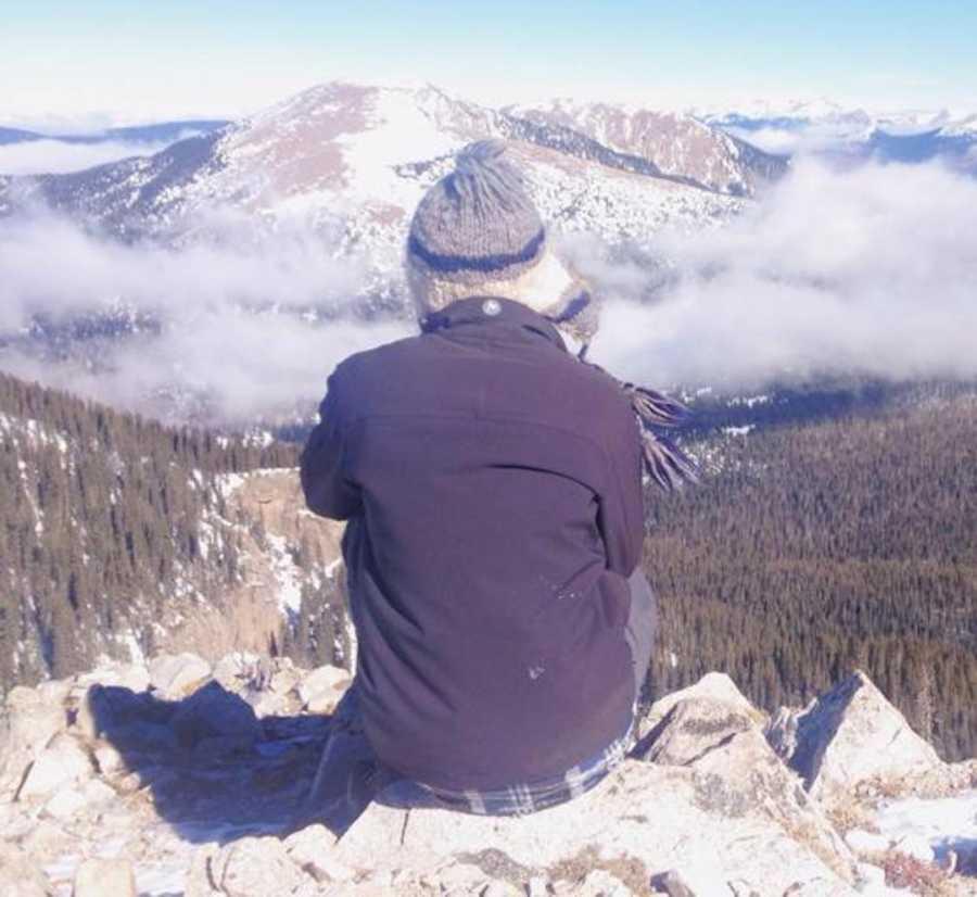 teenage boy staring at mountain