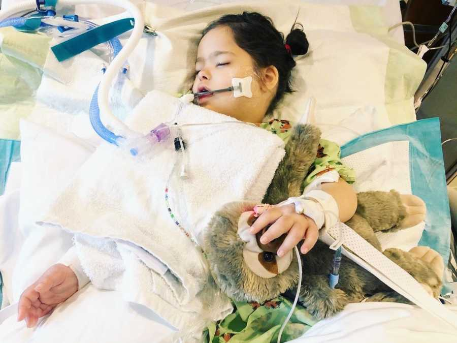 A special needs girl hooked up to machines in a hospital