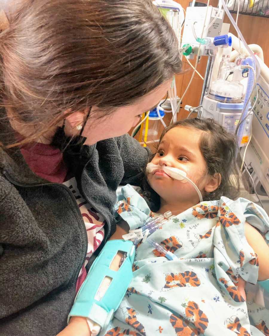 An adoptive mom holding her daughter in the hospital