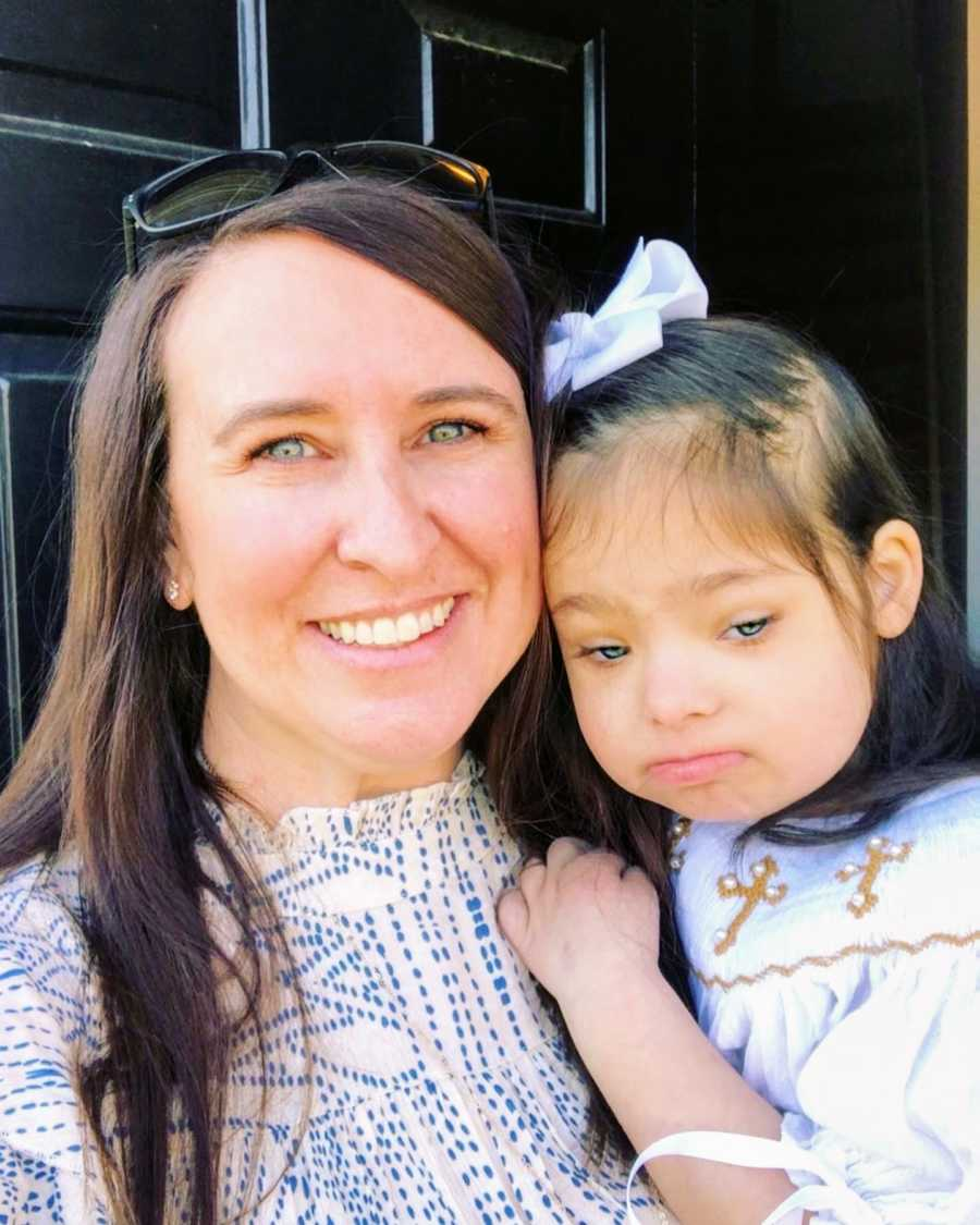 An adoptive mother and her daughter with Down Syndrome