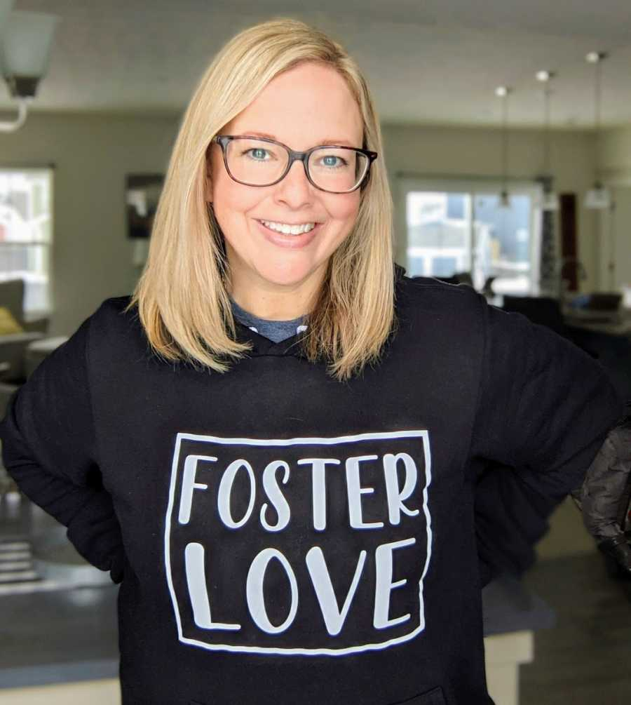 Foster mom smiling wearing foster love t-shirt
