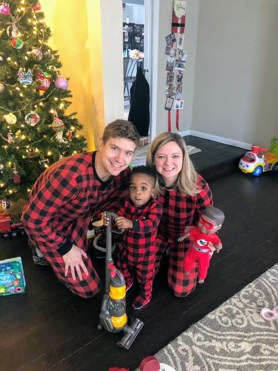Adoptive parents with their son at the holidays