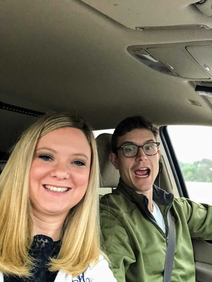 A couple in their car is surprised by good news