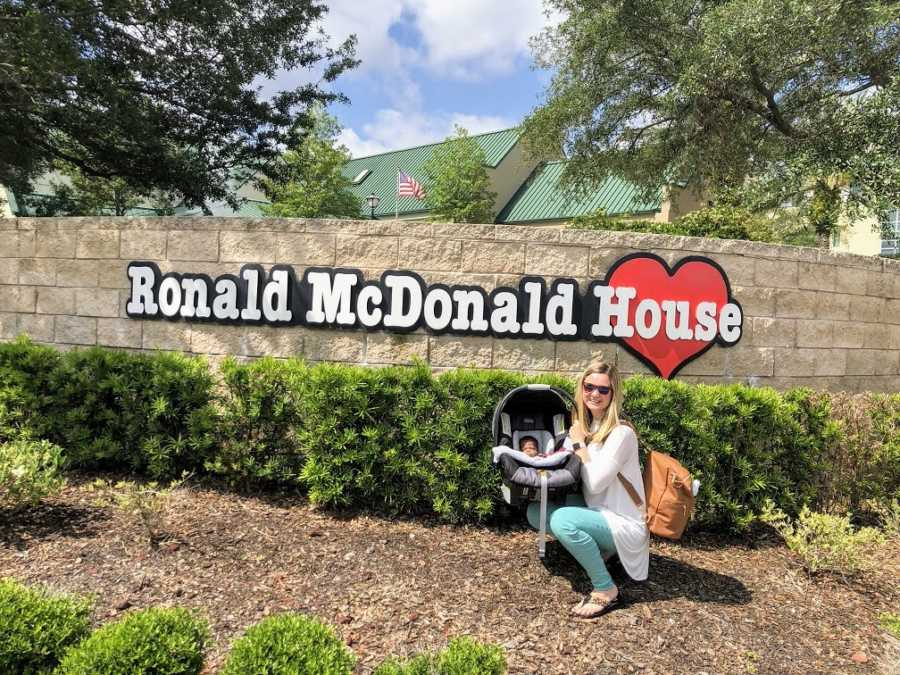 An adoptive mother with her baby outside the Ronald McDonald House