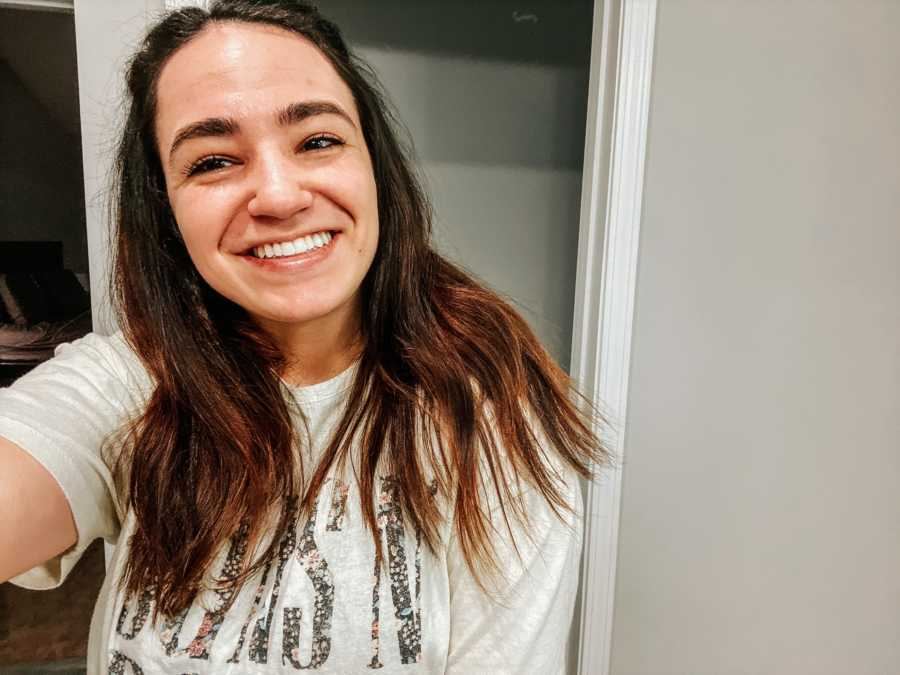 Young woman taking a smiling selfie