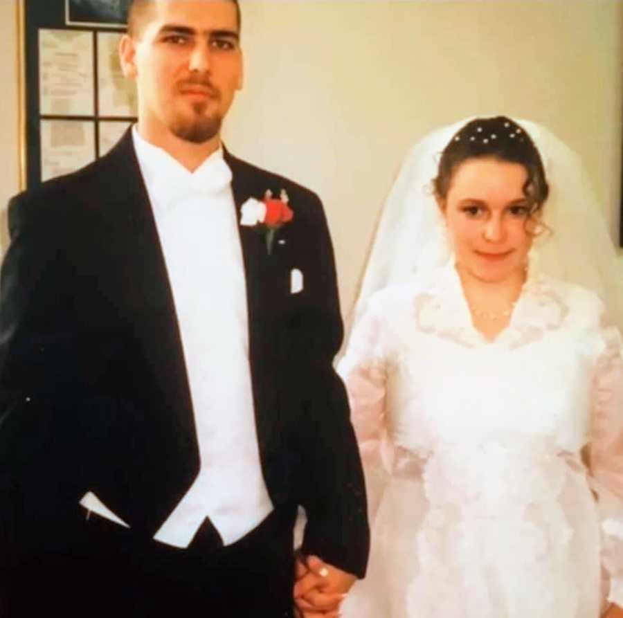 Newlyweds dressed in wedding attire