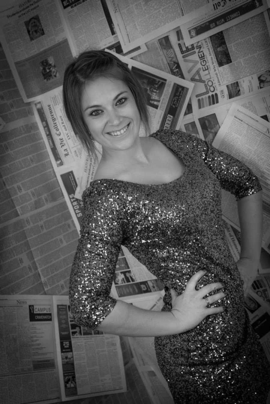 Black and white photo of smiling girl wearing sparkly shirt in