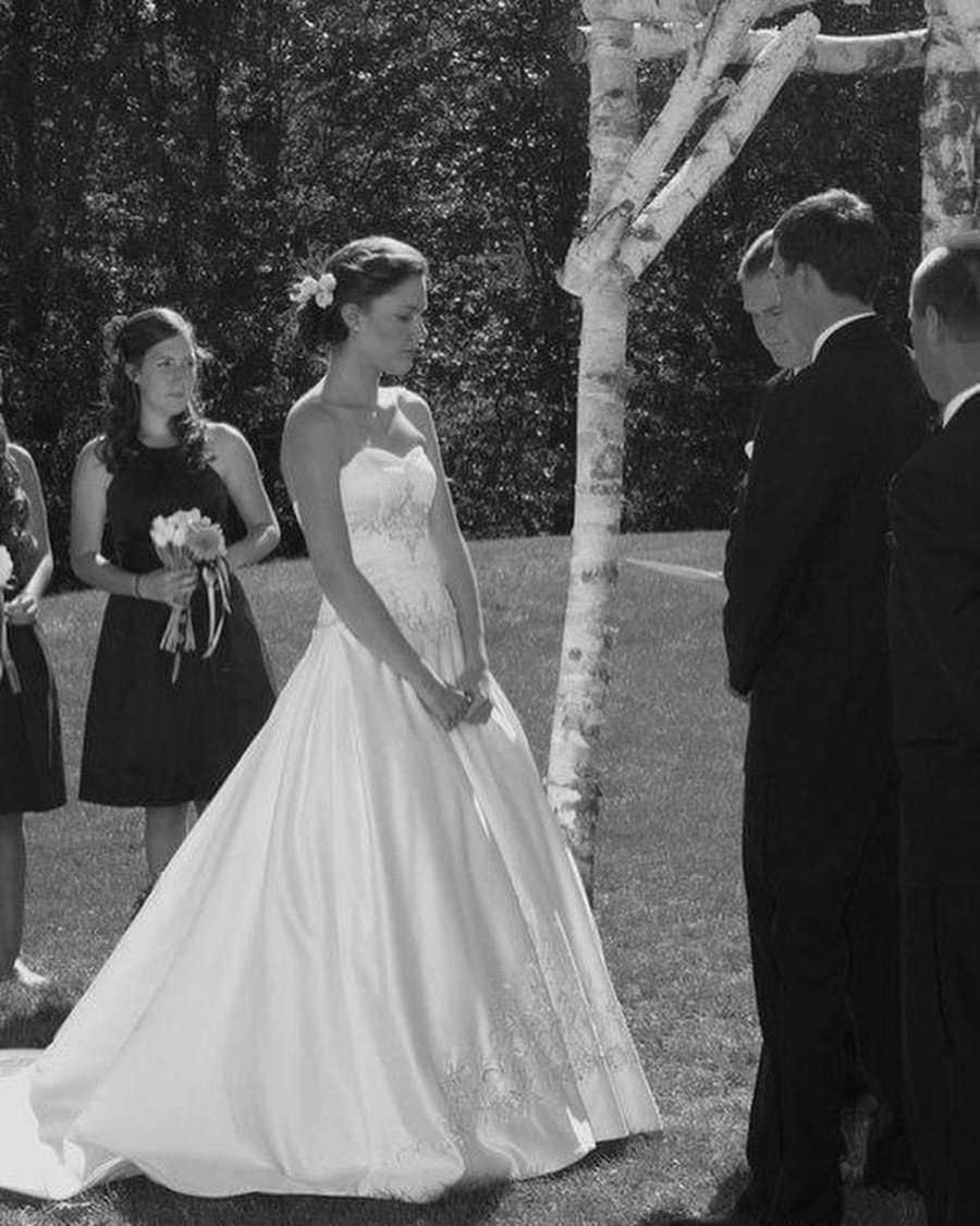 Bride and groom at wedding standing under altar