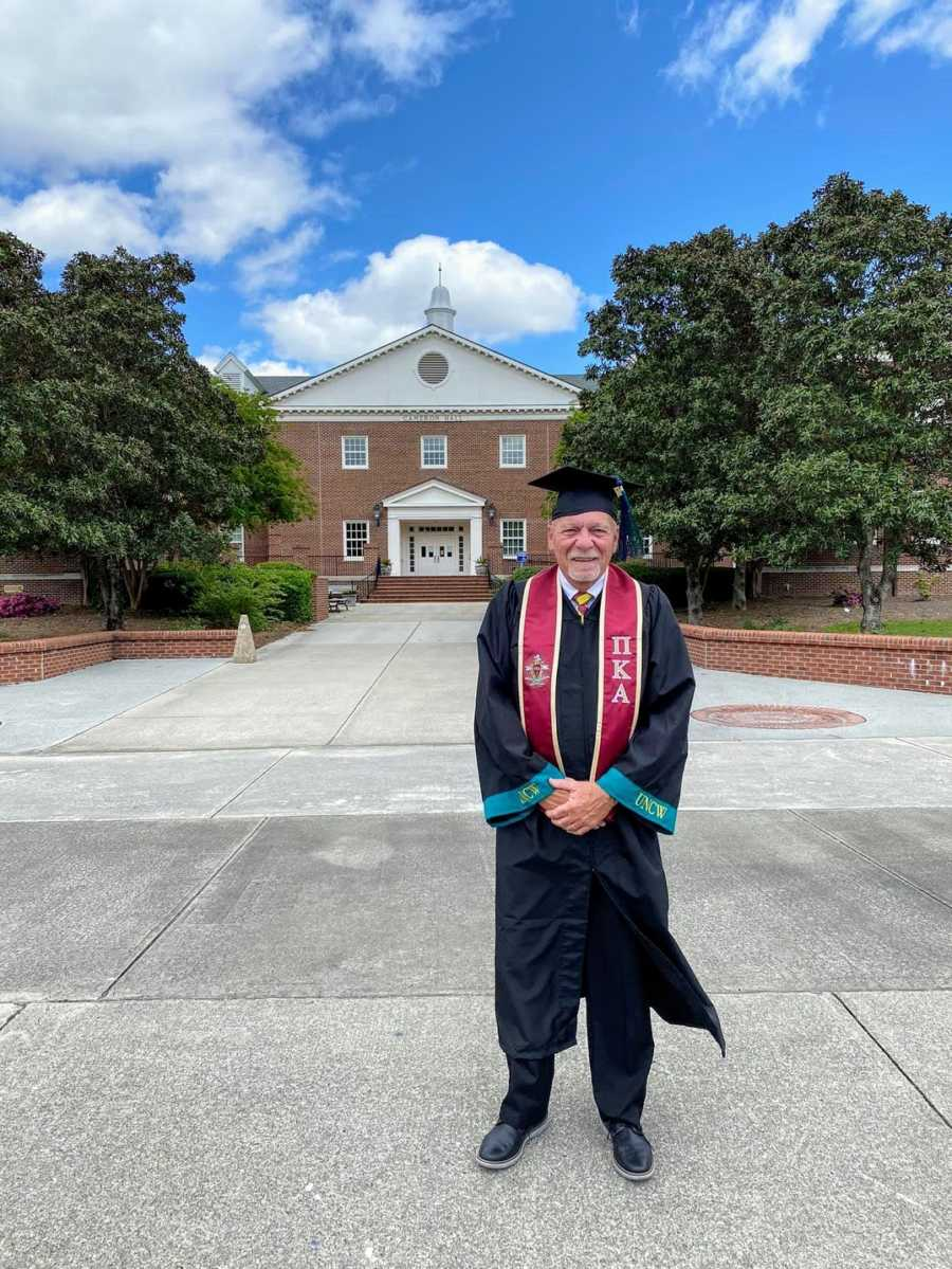 A nontraditional college graduate wearing cap and gown