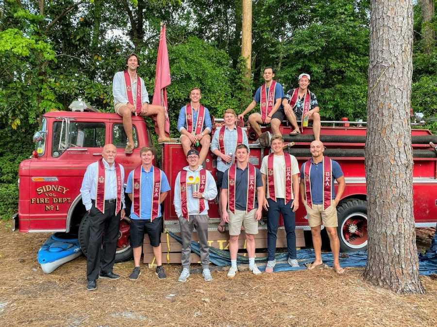 A nontraditional college student with the members of his fraternity