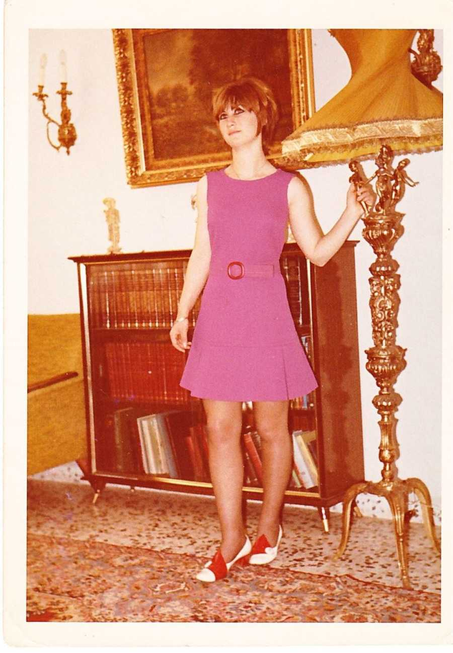 Young woman modeling in pink dress