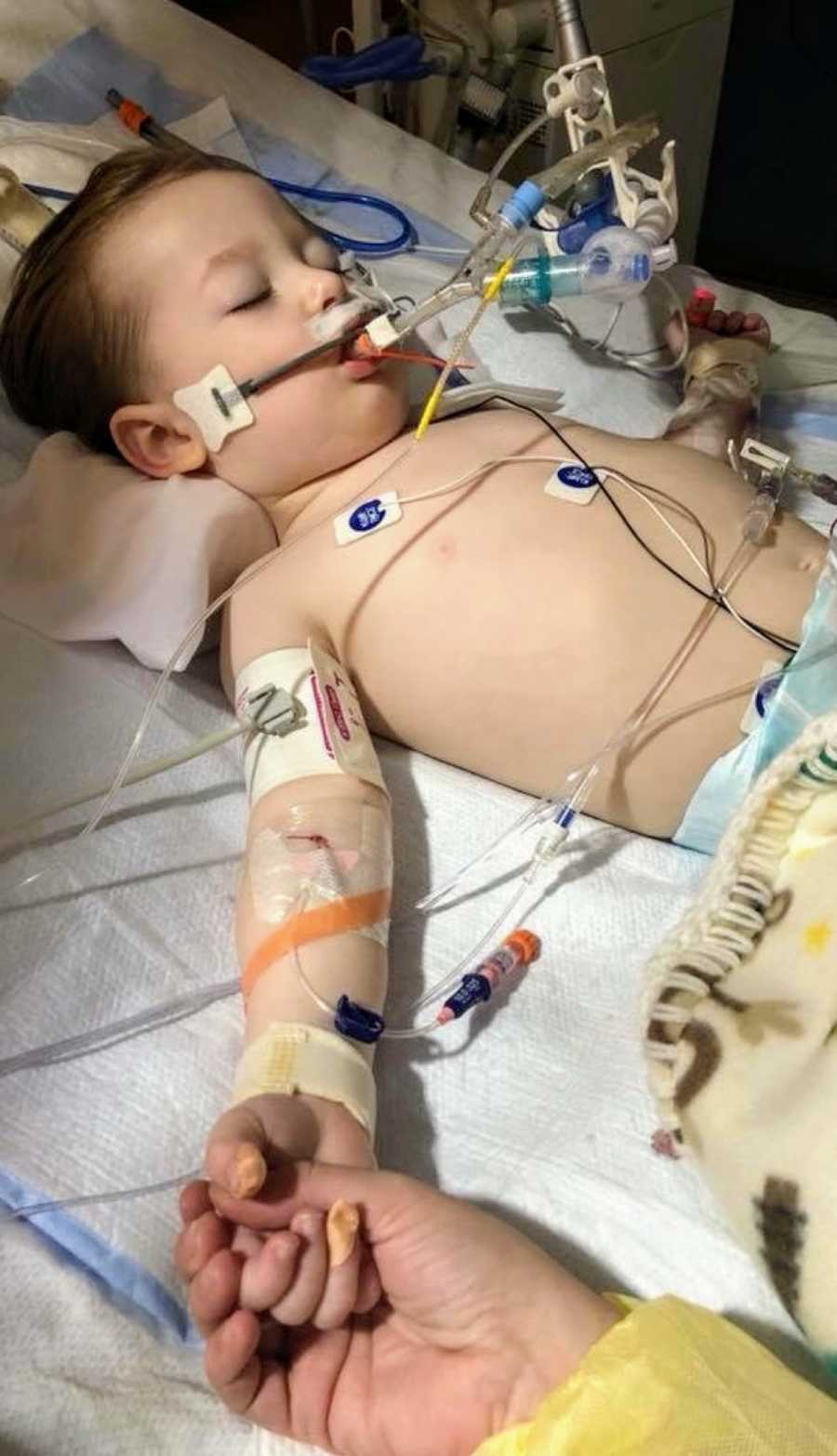 A two-year-old drowning victim hooked up to wires in hospital