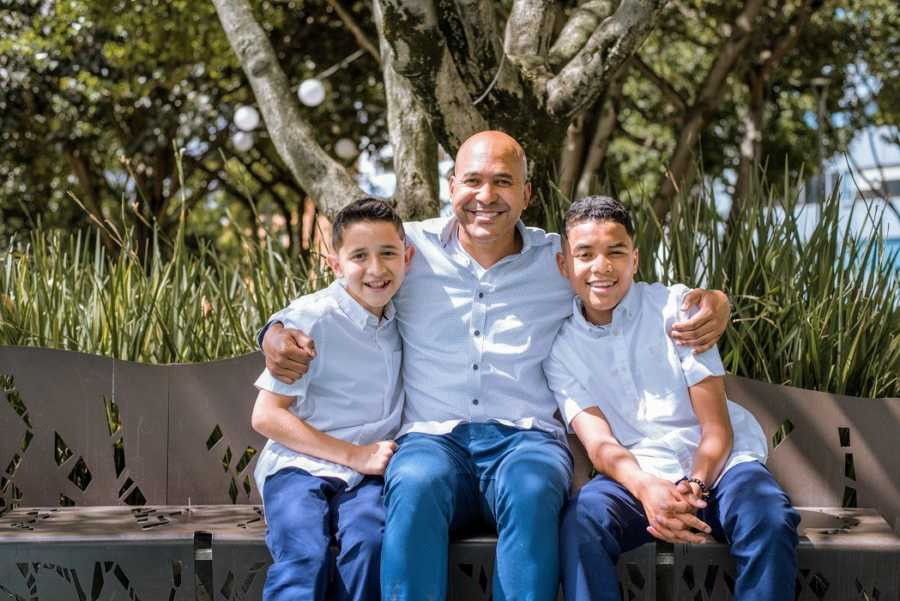 A single adoptive father and his sons in the park
