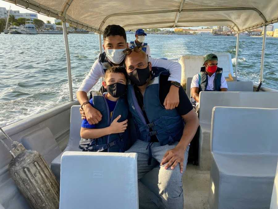 An adoptive father takes his sons out on a boat