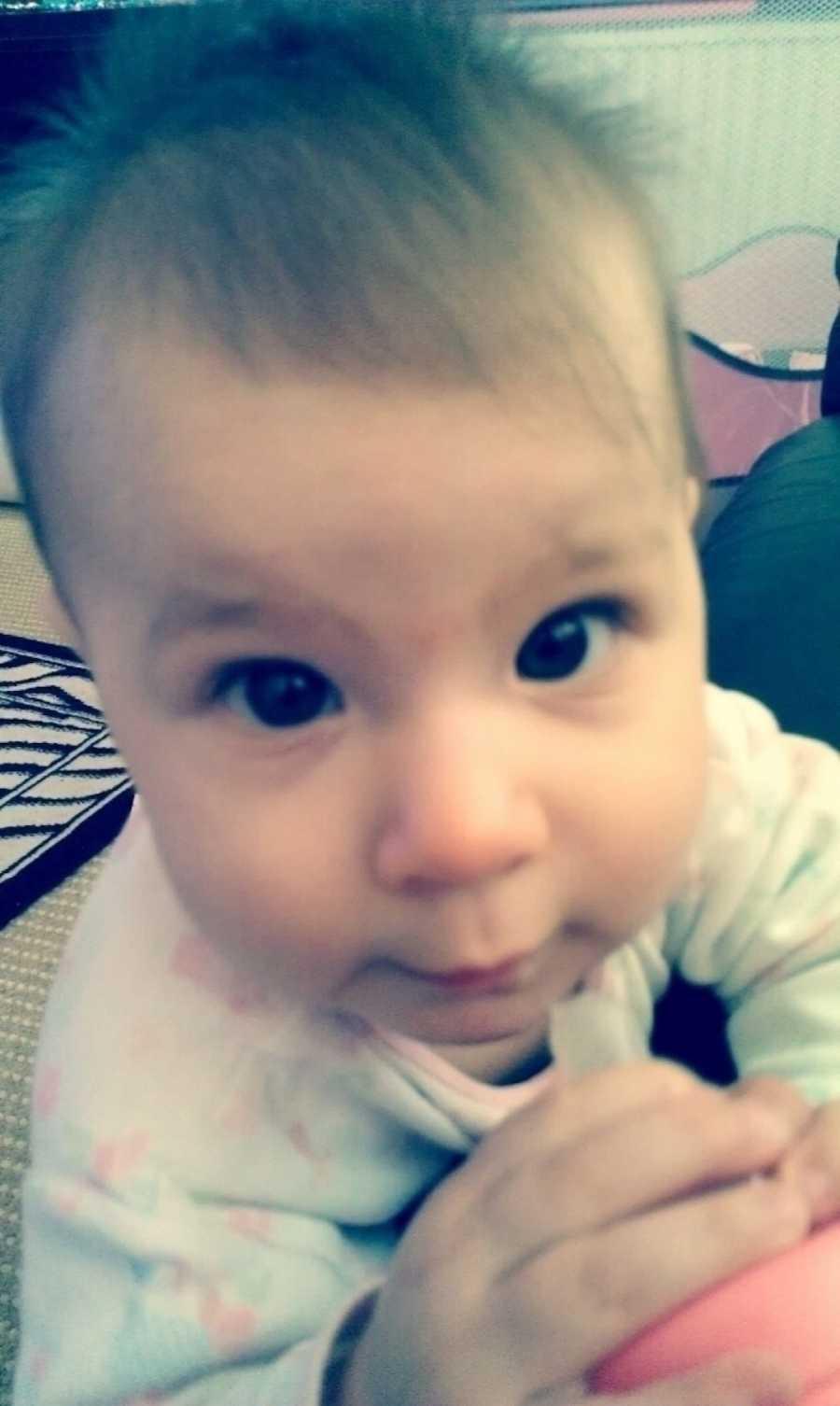 baby staring into camera