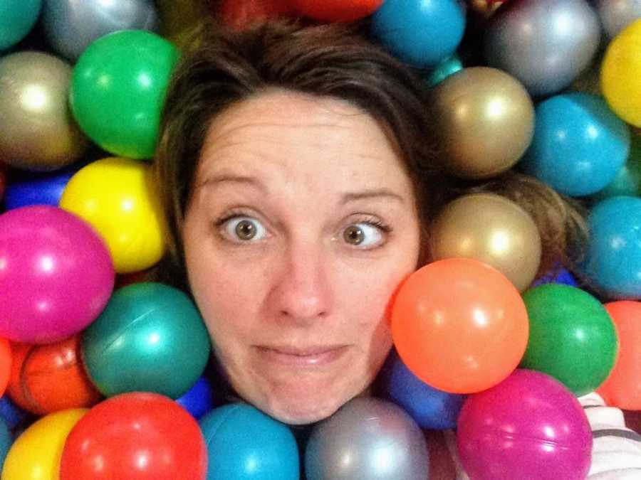 Woman in ball pit