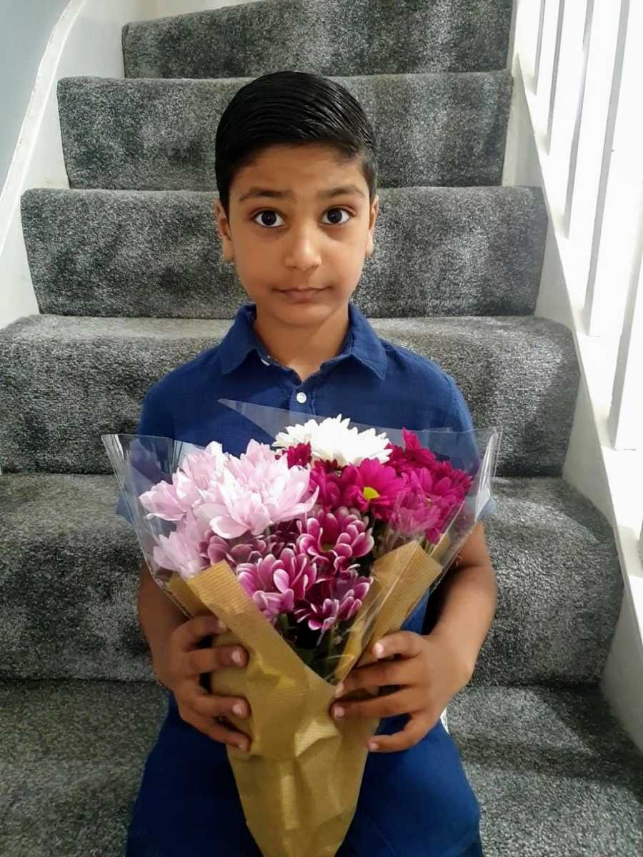 A boy with nonverbal autism holding flowers