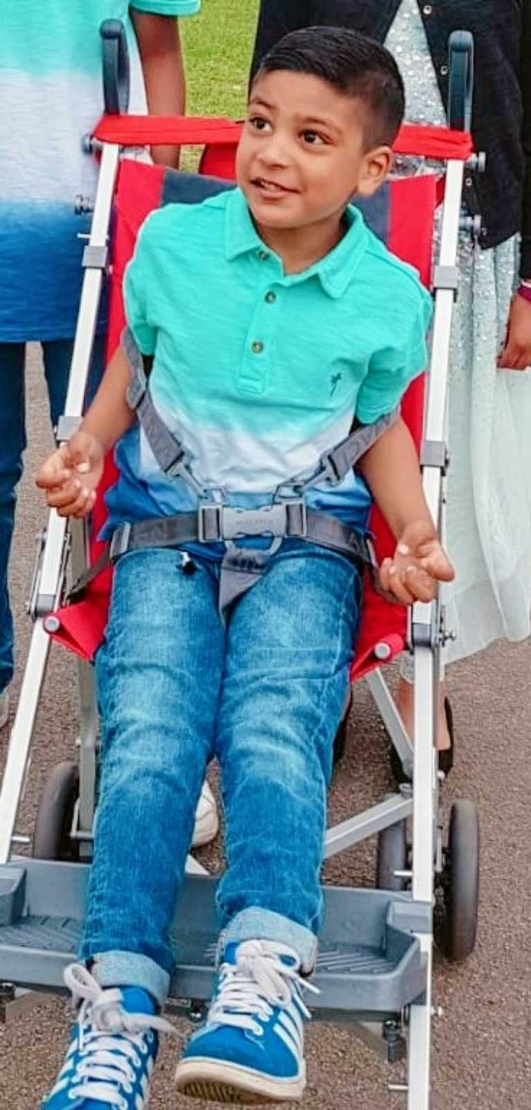 A boy with nonverbal autism sits in a stroller