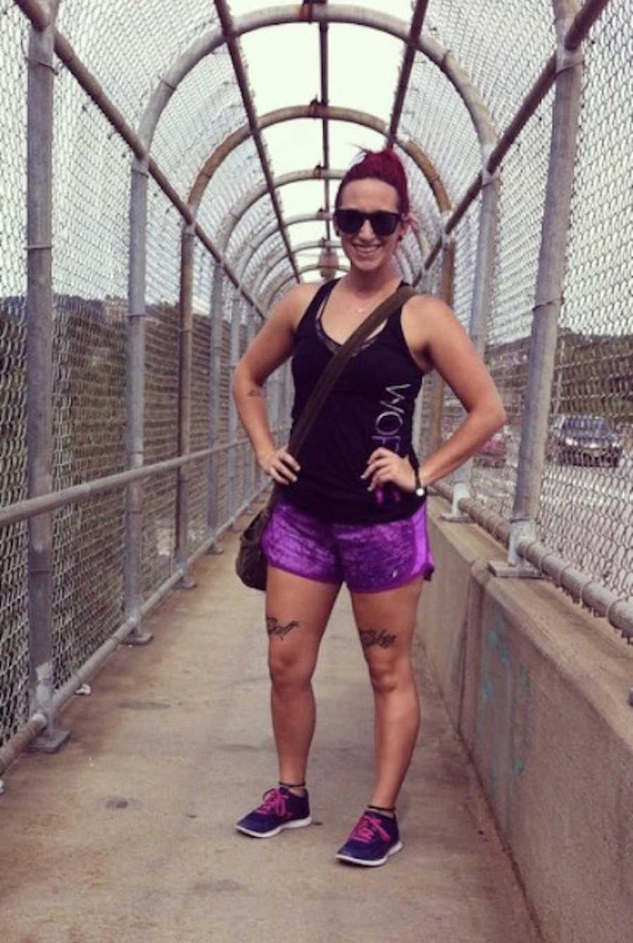 woman posing on a bridge