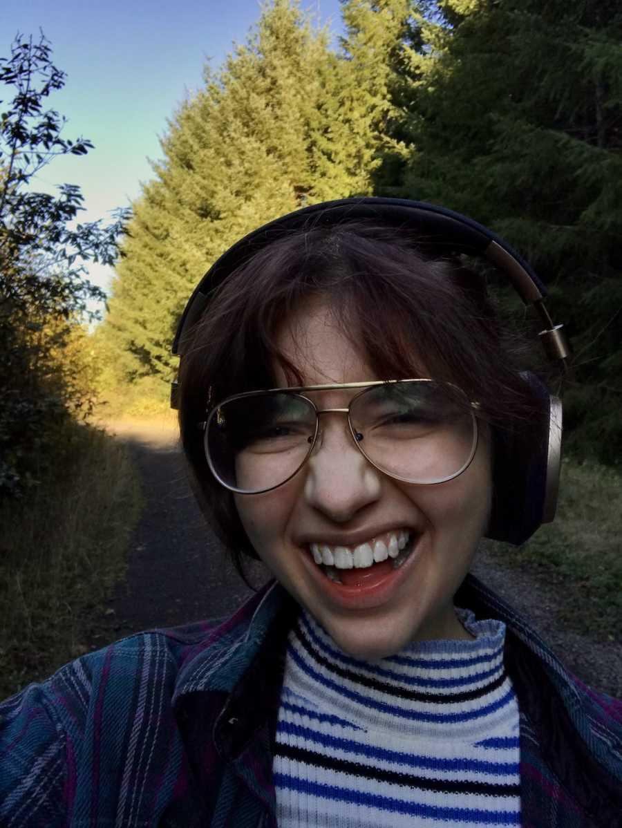 girl outside in headphones