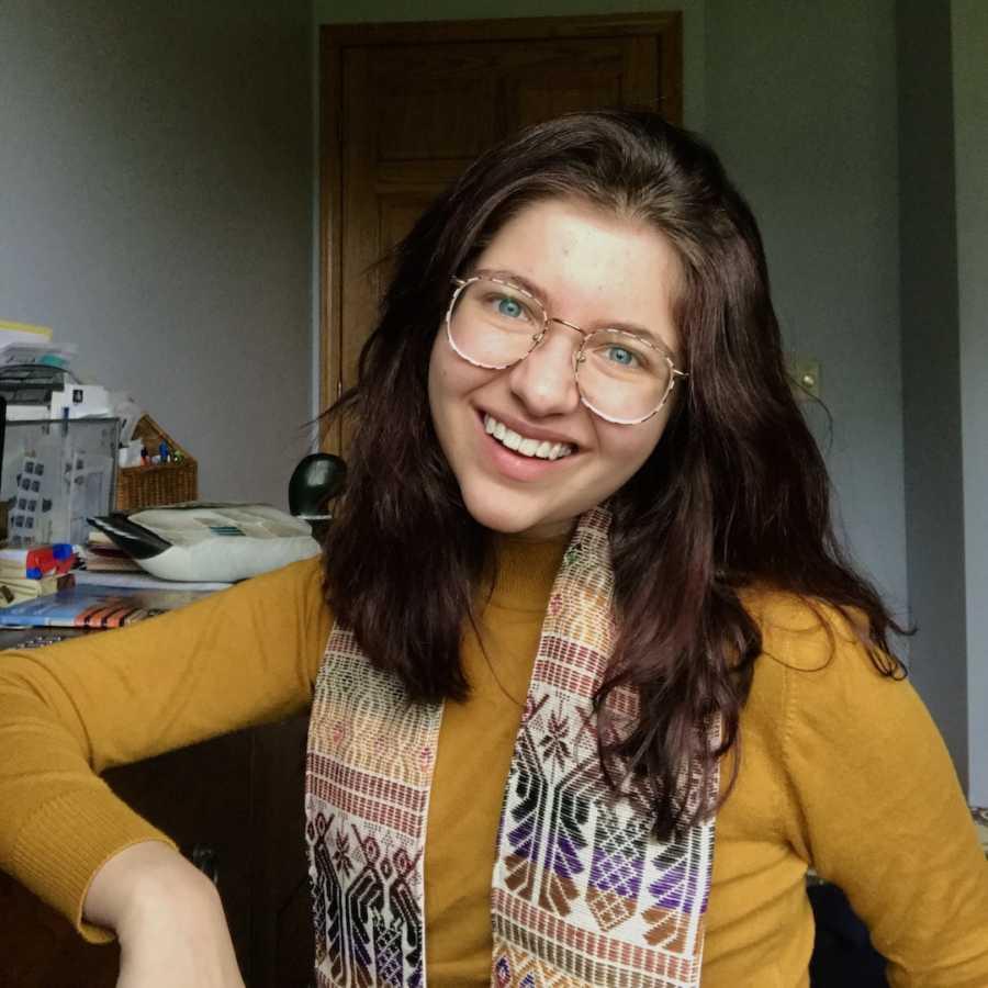 girl smiling in glasses