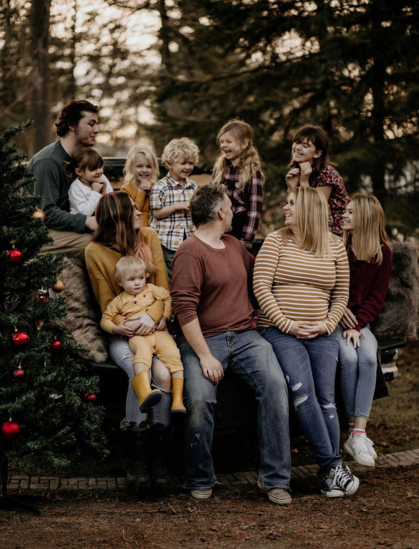 family of 10 posing outside