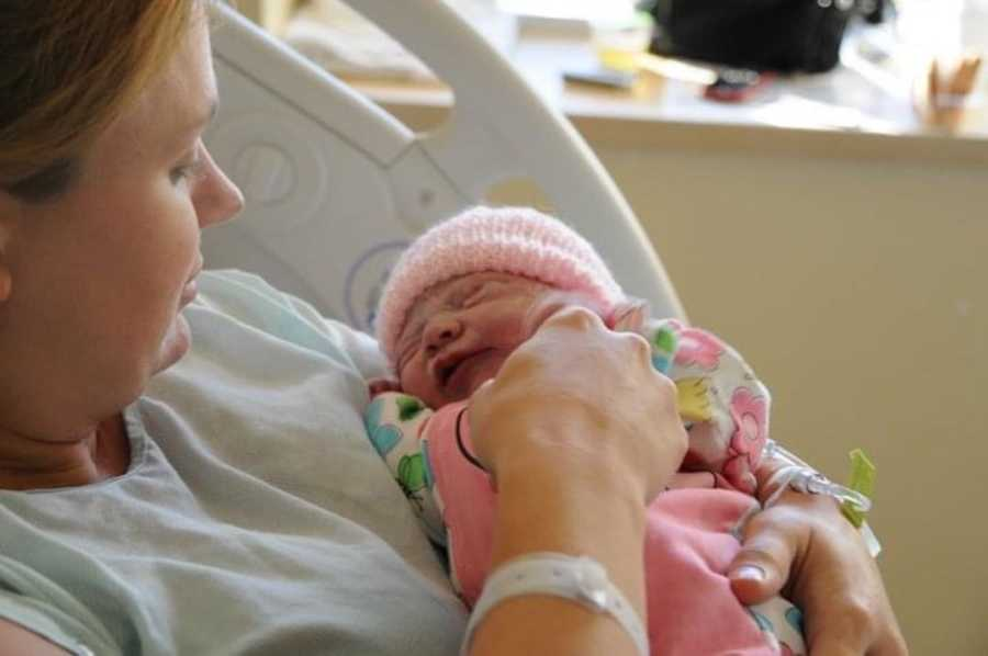 mom holding her newborn girl