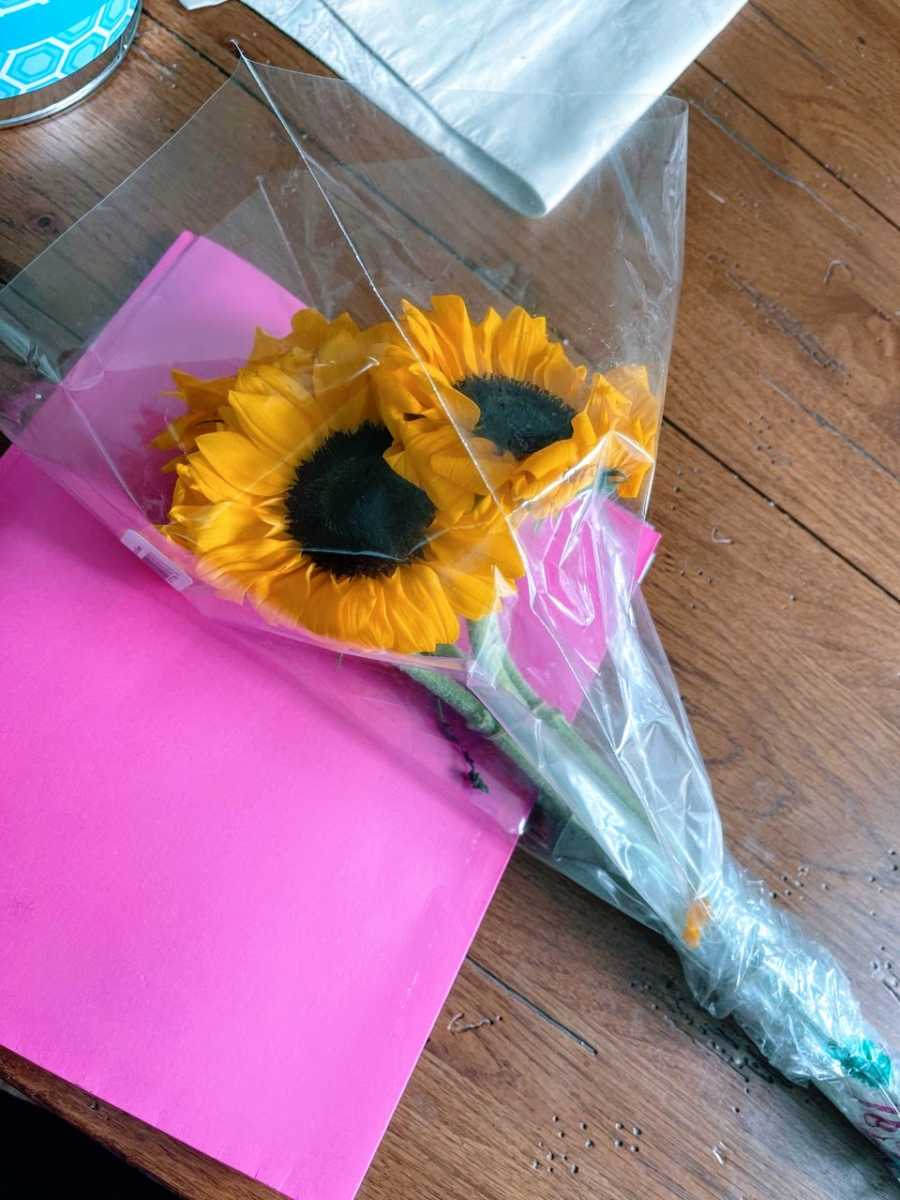 Woman battling cancer receives sunflowers and get well soon pictures from her son's bus