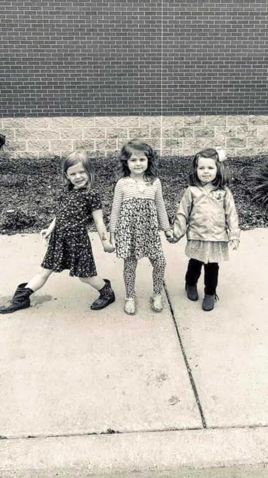 Mom takes photo of her three sassy, strong, and confident daughters