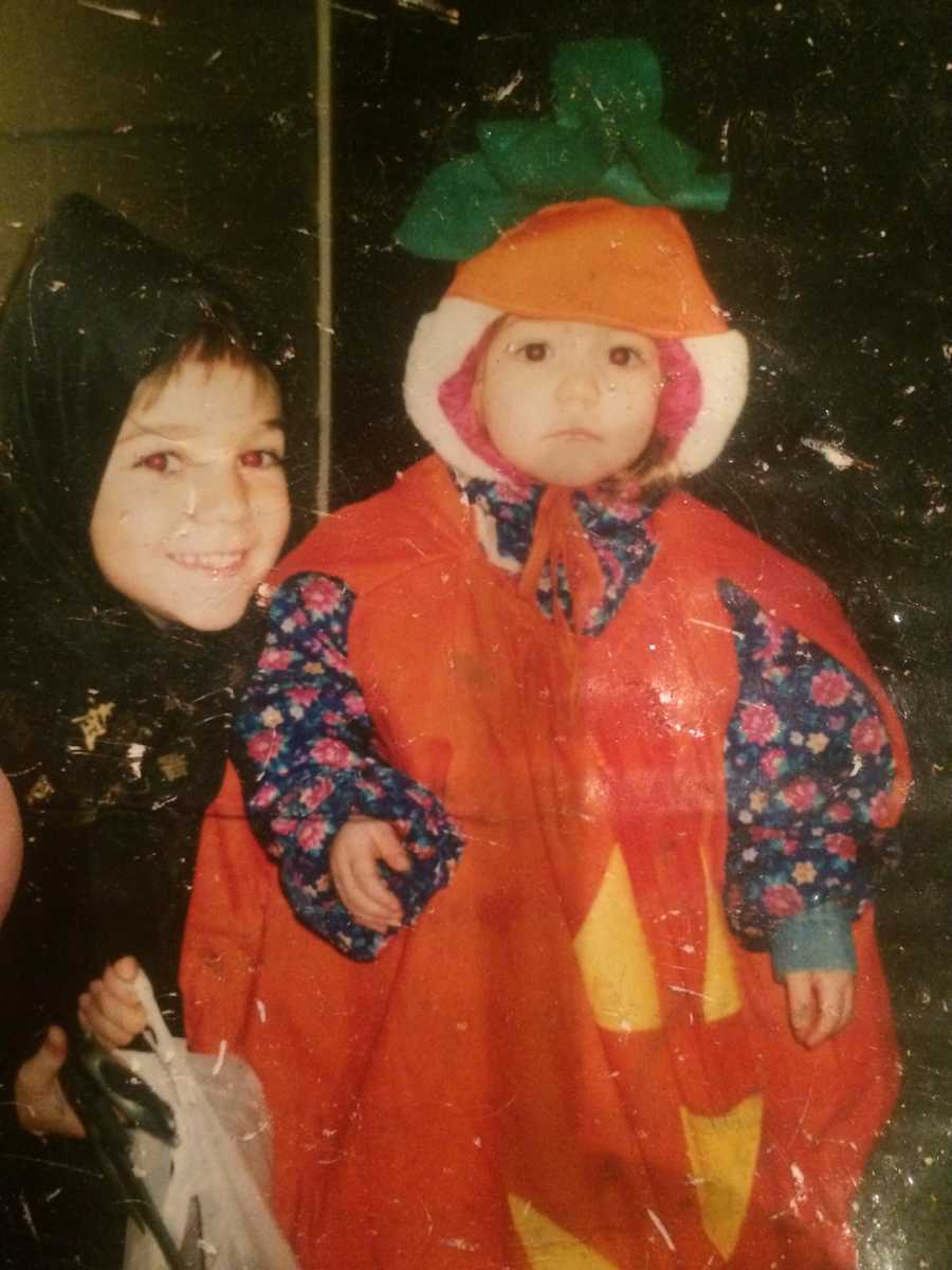 kid in pumpkin costume