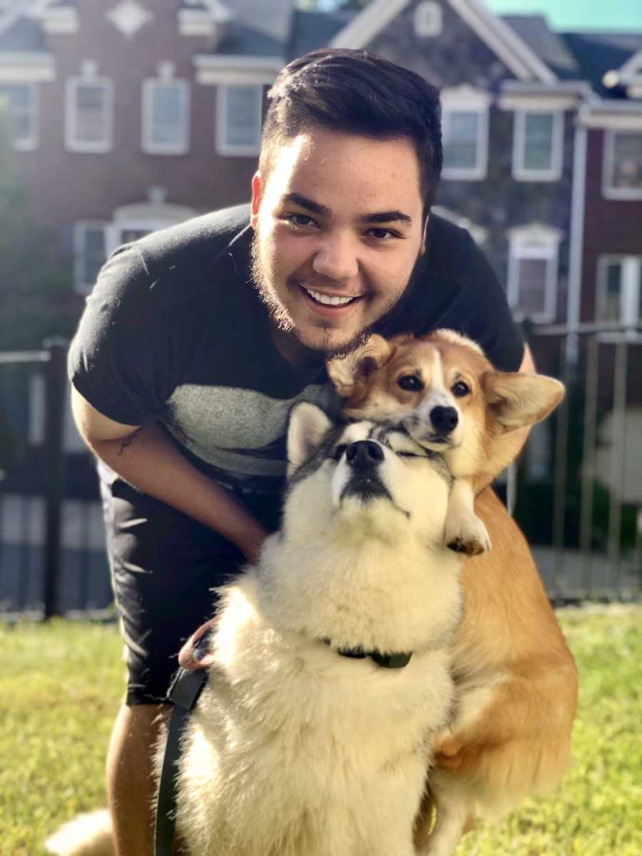 man with his dogs, smiling