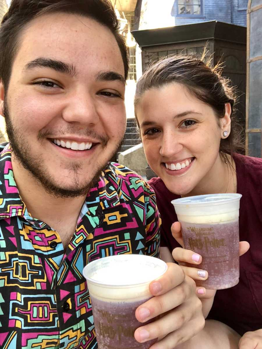 couple at Universal with butterbeer drinks