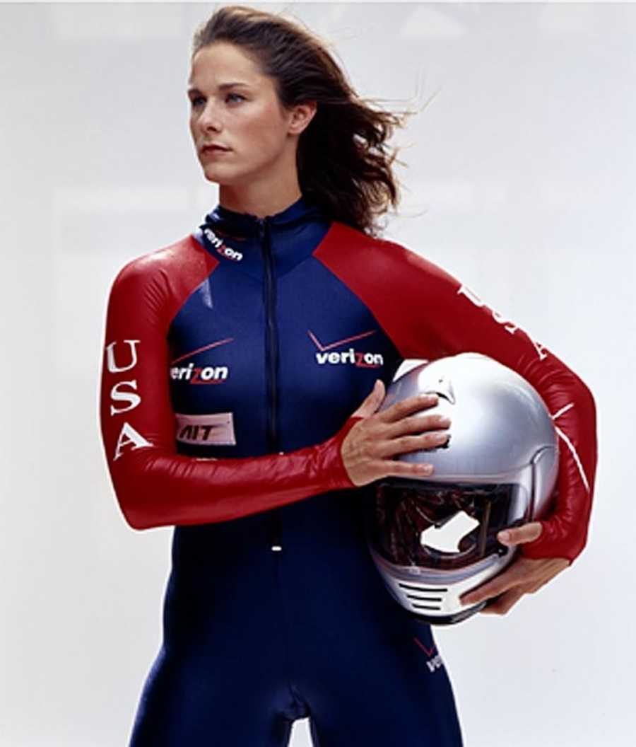 Olympian holding helmet