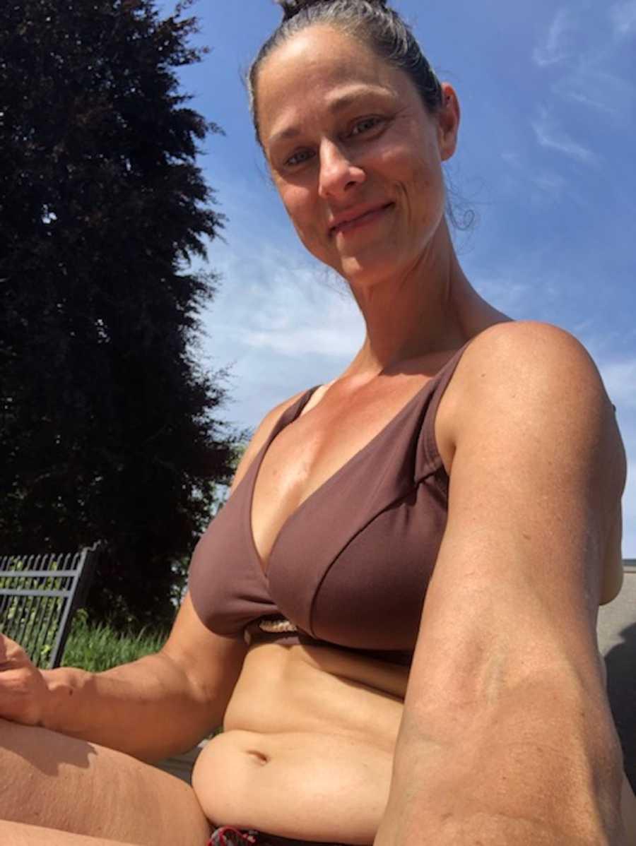 mom in bathing suit smiling