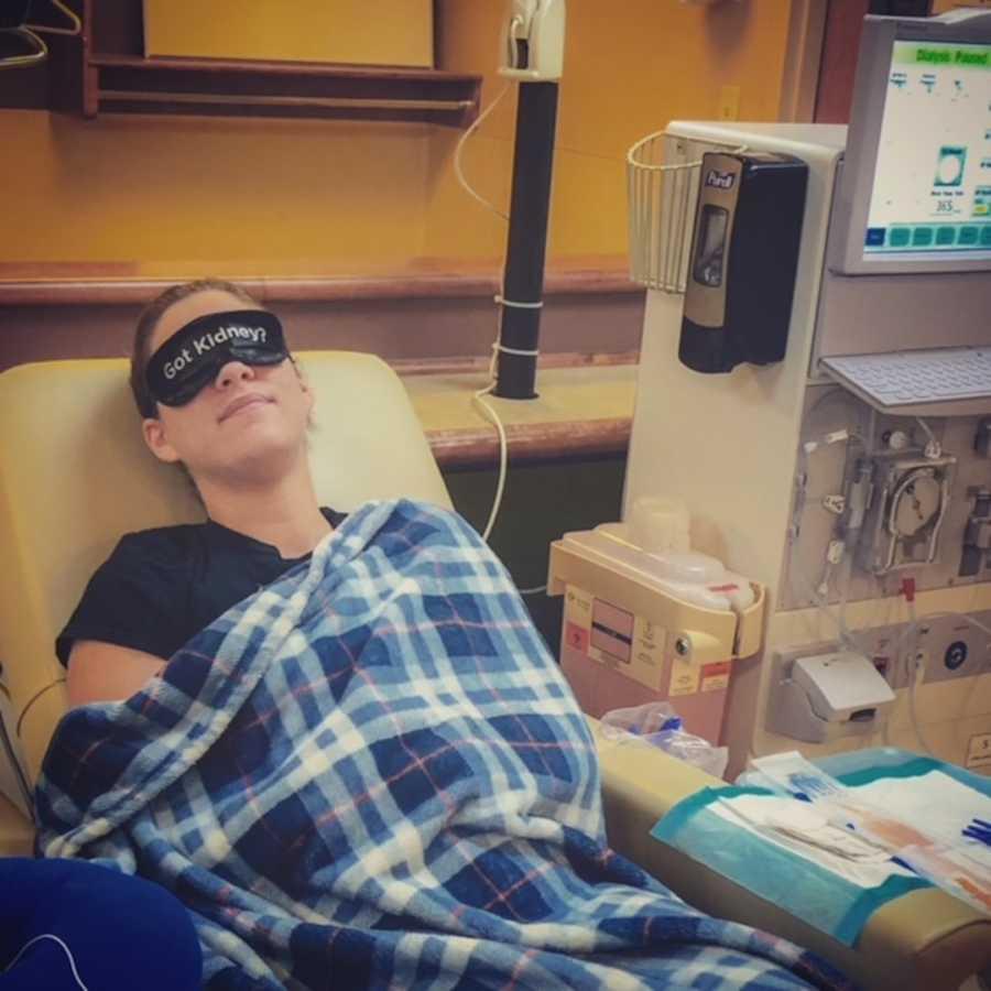 "woman in ""got kidney"" sleep mask in hospital bed"