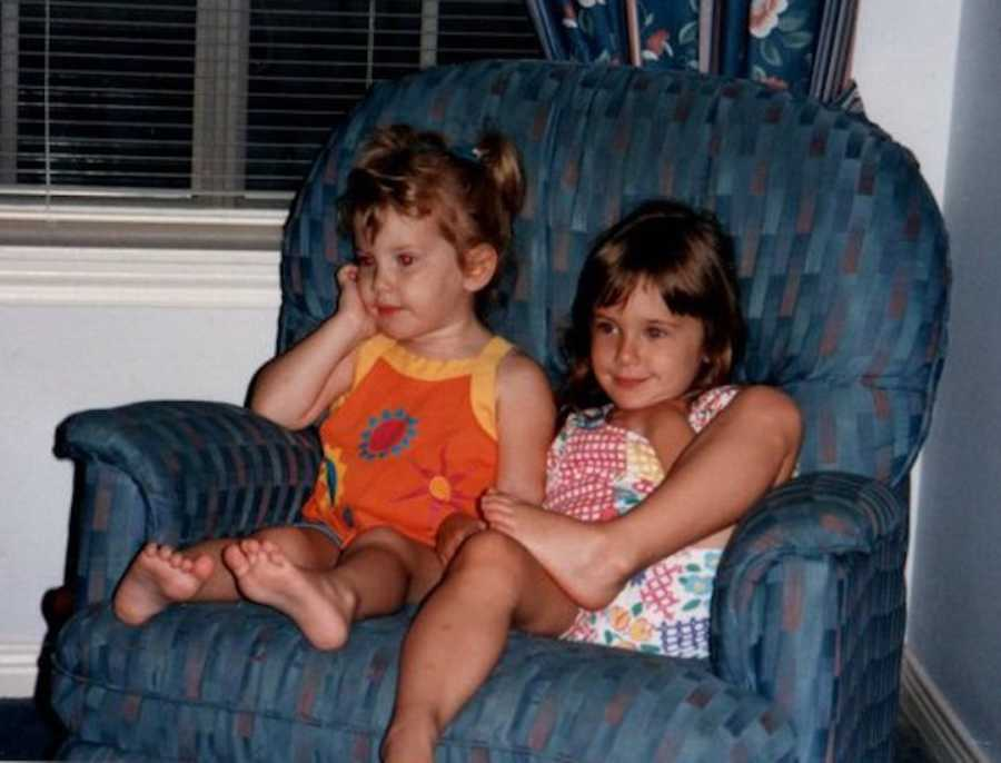 two young sisters on a chair