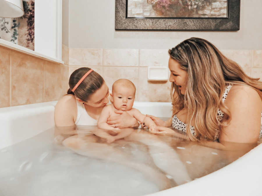 moms in bathtub with their son