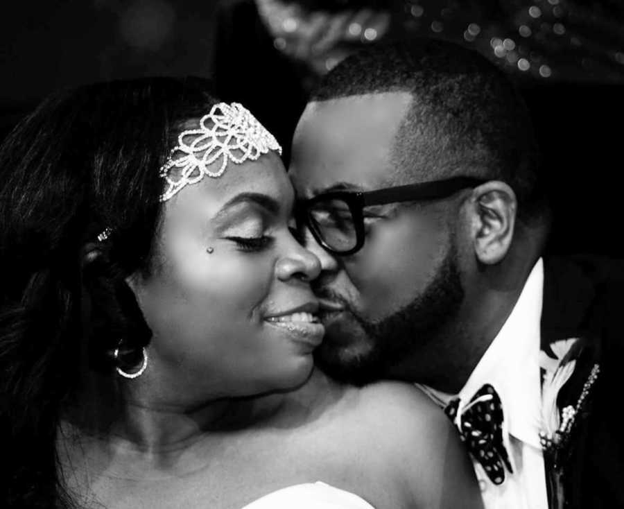 Couple share intimate moment during their wedding photoshoot