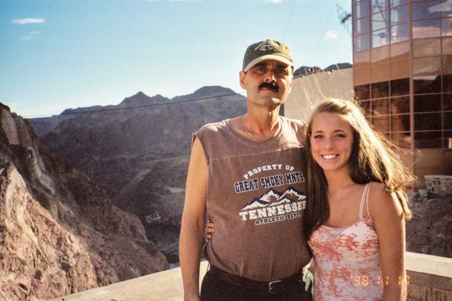 Father and daughter with arms around each other at national park