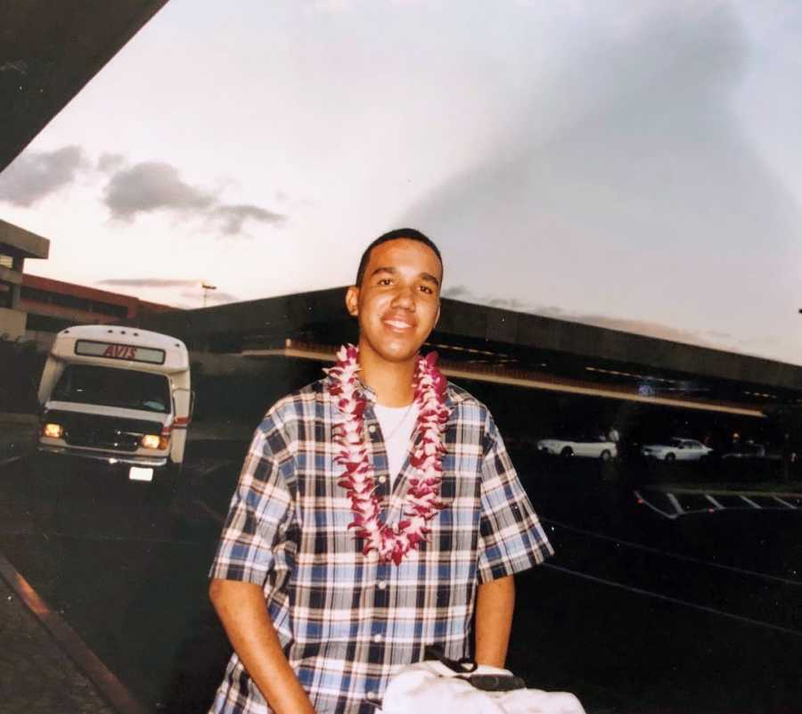 Man at airport in Hawaii wearing lei