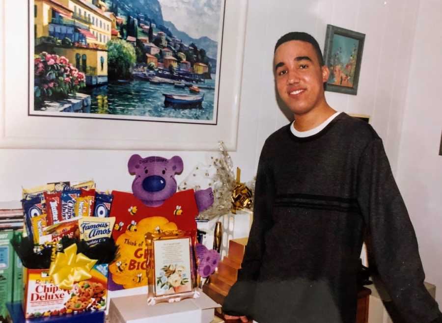 Young man posing with snacks and teddy bear