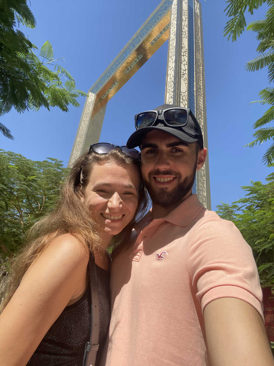 Man posing with girlfriend