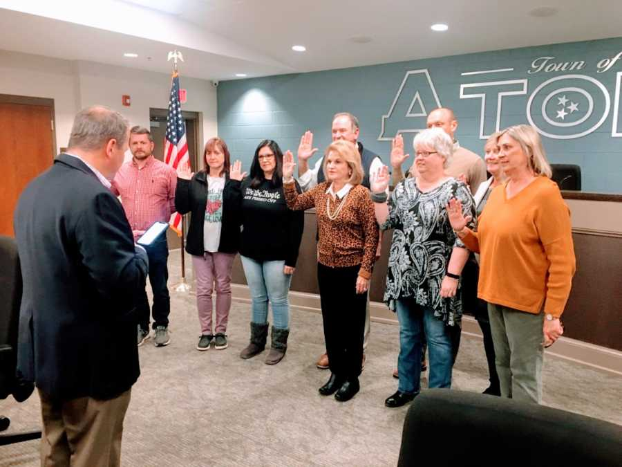 Woman being sworn into office on her local town's committee