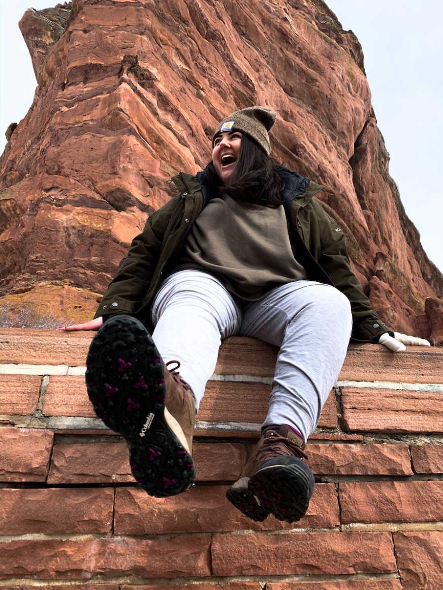 Woman posing at rock formation