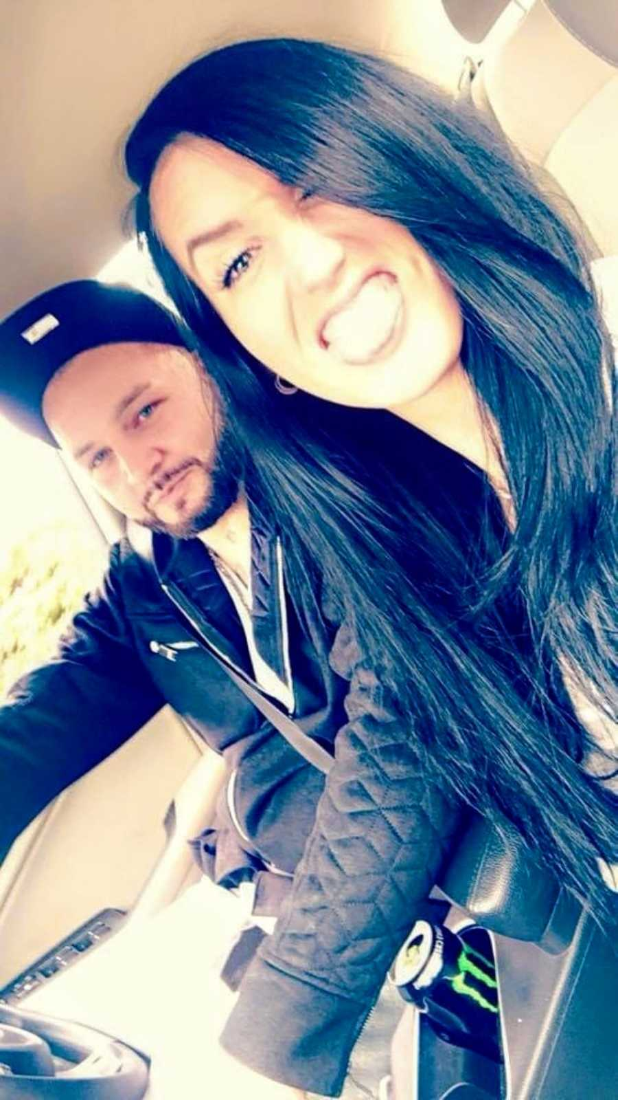 Couple take a silly selfie while driving around in their car