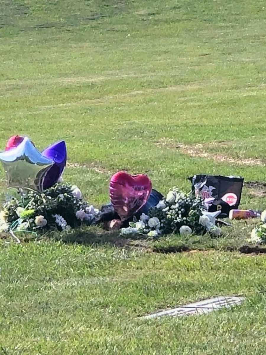 Woman lays down at her boyfriend's grave and cries